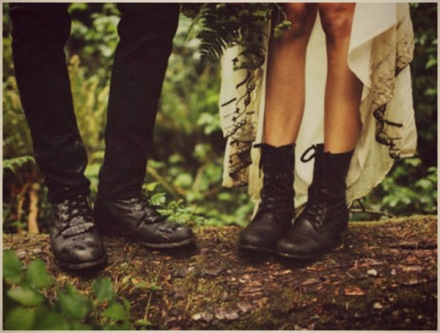 bride in black ankle lace up boots