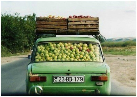 green vintage car with apples